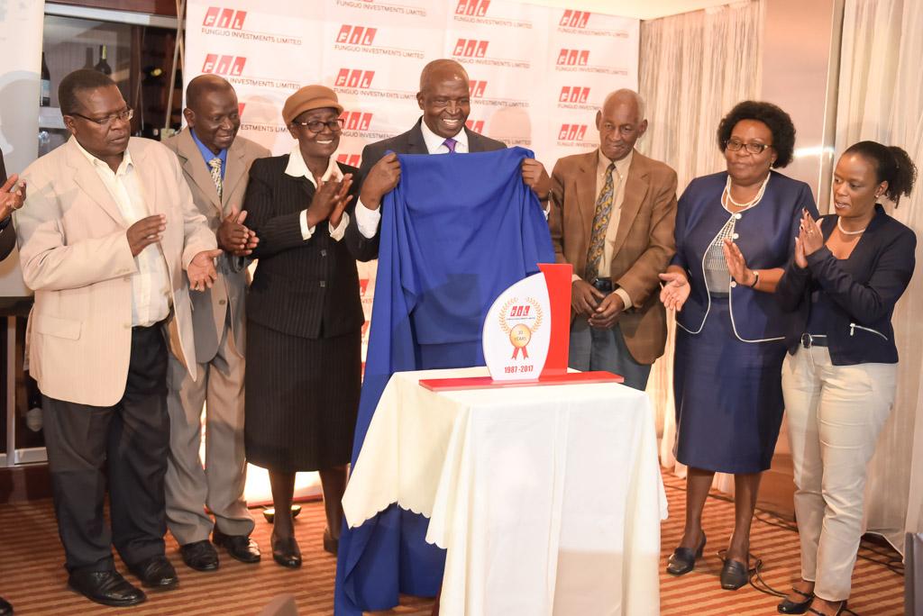FIL Chairman Unveiling a Plaque.